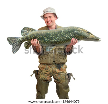 The fisherman with big fish (The Northern Pike - Esox lucius). Success concept. - stock photo