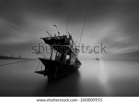 The fishing boat in black and white at Kon Ao Beach, Rayong, Thailand - stock photo