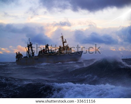 The fishing boat struggles for a life in a storm high water - stock photo