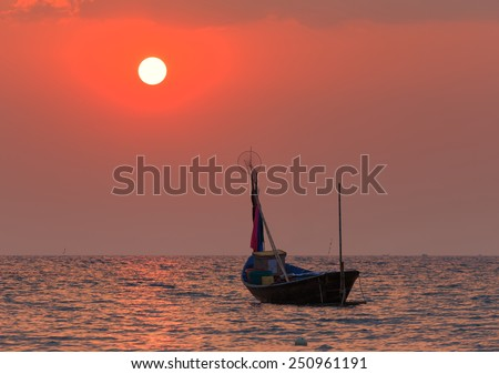 The fishing boat with a beautiful sunset, Thailand - stock photo