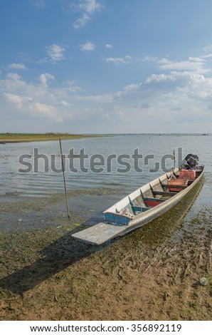 The fishing boats in the rivers with blue sky