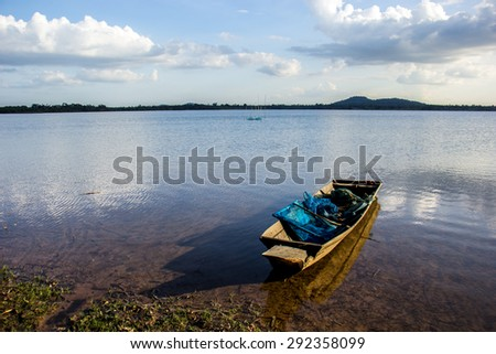 The Fishing boats, old, old, rivers, mountains, clear waters, beautiful, blue, turquoise, bright. - stock photo