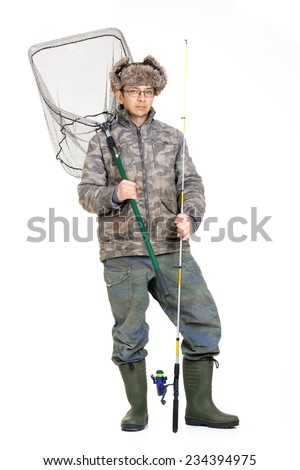 The fishing man in photo studio in old fishing clothes with fishing rod - stock photo