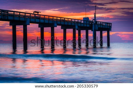 The fishing pier at sunrise, in St. Augustine Beach, Florida. - stock photo