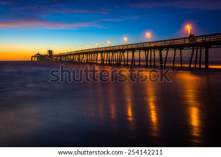 The fishing pier seen after sunset, in Imperial Beach, California. - stock photo
