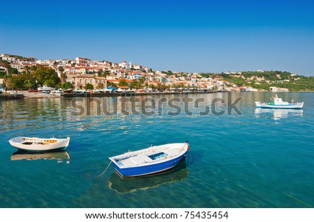The fishing town of Koroni, in southern Greece, captured under a clear morning sky - stock photo