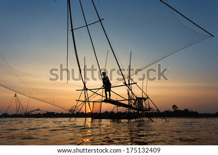 The fishing village at Udonthani province, north-east of Thailand. They still use the classic tool for fishing. This photo was shot at the sunset time.