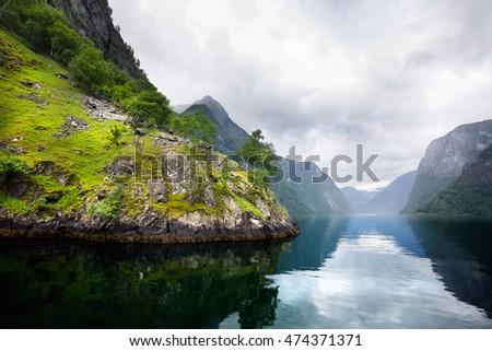 The fjord in the summer in cold cloudy weather, Norway