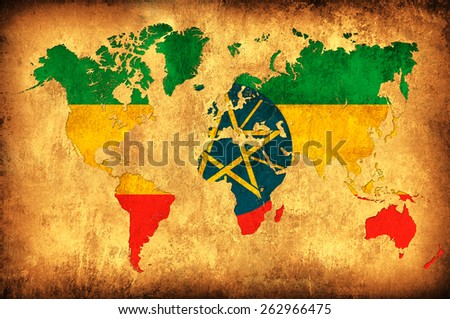 The flag of Ethiopia in the outline of the world map - stock photo