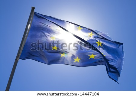 The flag of europe in the wind opposite the sun