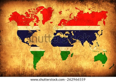 The flag of Gambia in the outline of the world map - stock photo