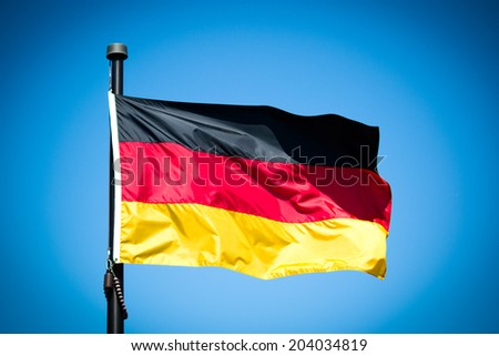 The Flag of Germany blowing in the wind. - stock photo