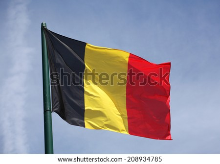 The Flag of Germany blowing in the wind - stock photo
