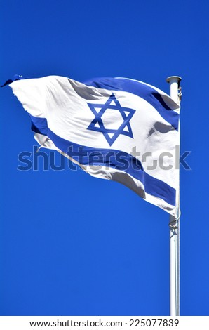 The flag of Israel against blu sky background, - stock photo