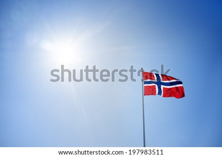 The flag of Norway agains sunny sky. - stock photo