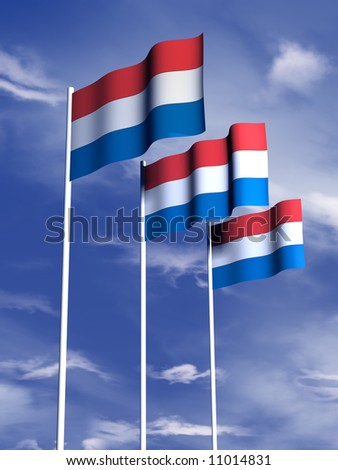 The flag of the Netherlands or Holland flying under a blue sky