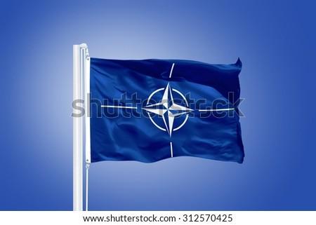 The flag of the North Atlantic Treaty Organization NATO. - stock photo