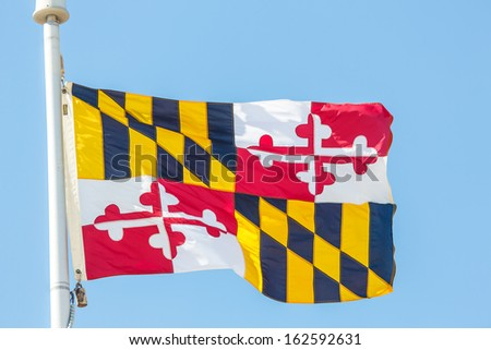 The flag of the state of Maryland against blue sky - stock photo