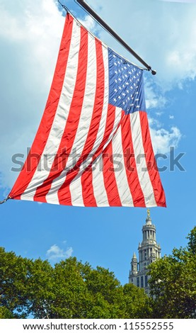 The flag of United States seen in the center of New York City on a sunny day