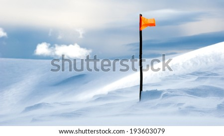 The flag on top of a snowy mountain - stock photo