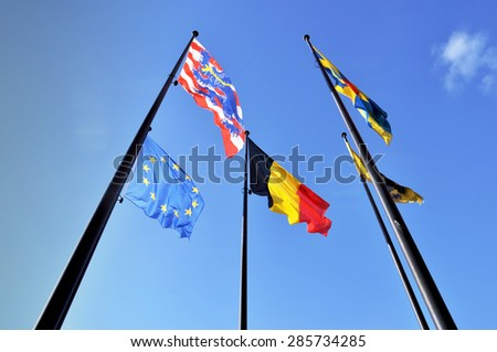 The flags of Bruges, West Flanders, Belgium, and the European Union - stock photo