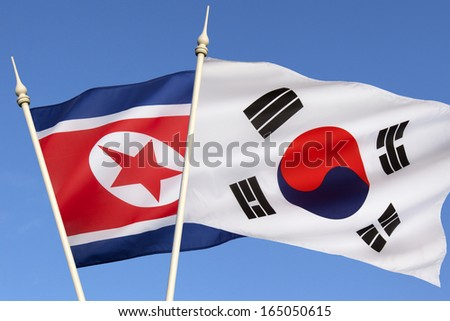 The flags of North Korea and South Korea - stock photo