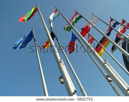 The flags of some countries on background blue sky.
