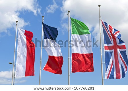 The flags of some European countries on a sky background.