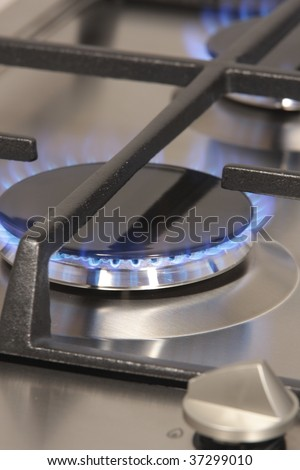 The flame of gas burner on the hob - stock photo