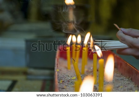 The flame of the candle is light - stock photo
