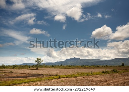 The flat grassy plains in the outskirts of Kalay in the Mountains of Chin State, Myanmar (Burma) - stock photo
