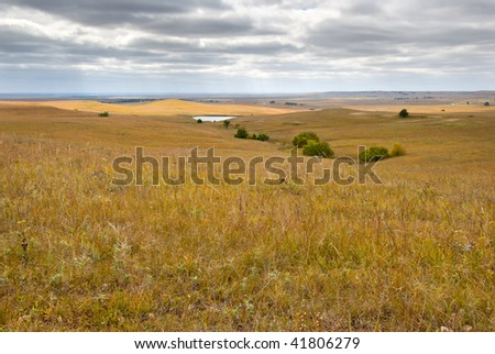 The Flint Hills in Kansas with the prairie grasses in golden autumn color. - stock photo