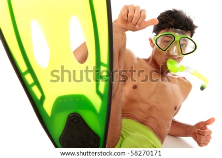 The flipper of a young Nepalese athletic man in swimsuit with goggles and snorkel lying down with thumbs up. Studio shot. White background - stock photo