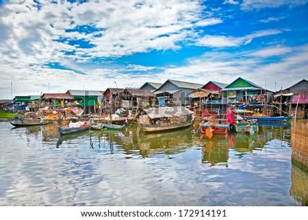 The floating village on the water (komprongpok) of Tonle Sap lake. Cambodia. - stock photo