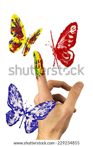 The flock of painted butterflies flying around painted finger - stock photo