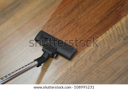 the floor clean with a vacuum cleaner - stock photo
