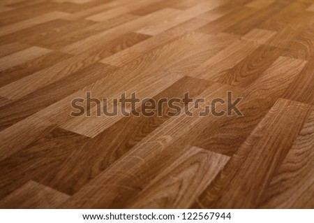 The floor of the light brown laminate diagonally