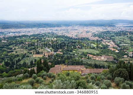 the Florence dome in a far away panorama seen from Fiesole with the river Arno flowing - stock photo