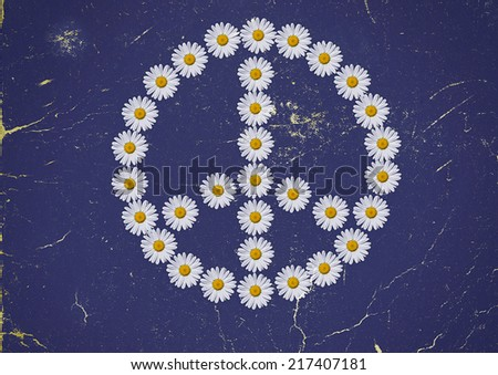 the flower power symbol made in daisies flower - stock photo