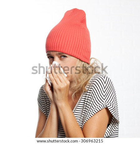the flu illness, a young girl sneezes disease - stock photo