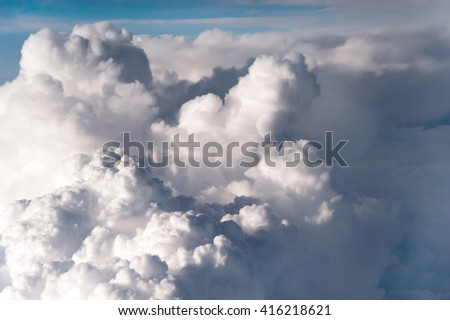 The fluffy clouds formation, view from airplane windows. Sunny sky abstract background, beautiful cloudscape, vertical Freedom concept - stock photo