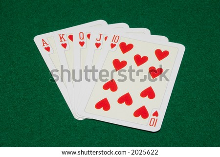 the flush royal combination on green cloth background