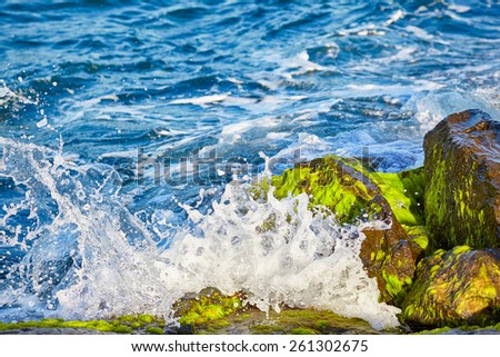 The foamy waves of the Bosphorus beating against the rocks.  Istanbul, Turkey - stock photo