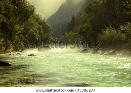 The fog on the river through the Alpine valley. The Soca river, Slovenia - stock photo