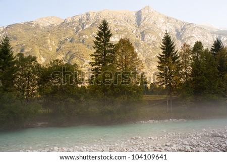 The fog on the Soca river, Slovenian Julian Alps - stock photo