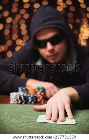 The Fold / Poker player folding his cards in a casino - stock photo