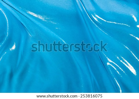 The folds of blue silk fabric fluttering in the wind - stock photo