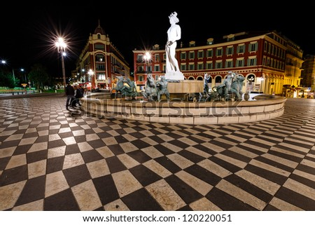 The Fontaine du Soleil on Place Massena at Night, Nice, French Riviera, France - stock photo