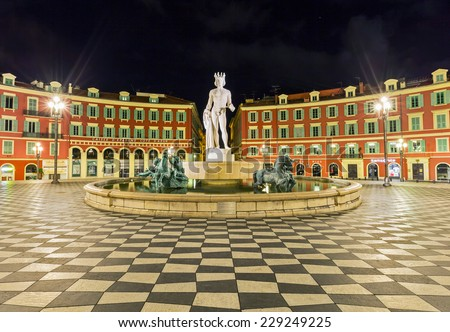 The Fontaine du Soleil on Place Massena in the nights, Nice, French Riviera, France - stock photo
