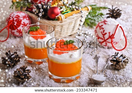The food is orange with cream cheese and red caviar on the background of Christmas decorations - stock photo
